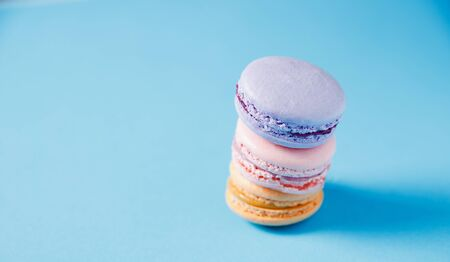 Colorful Cake macaron or macaroon on blue background, pastel color