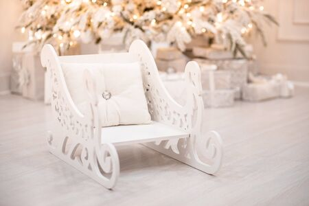 Interior Christmas room silver retro sleigh chair white in light illuminations. 版權商用圖片