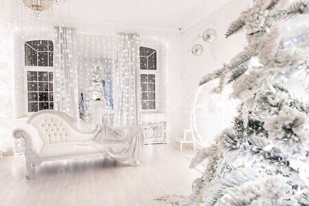 Interior Christmas room silver retro sofa white in light illuminations.