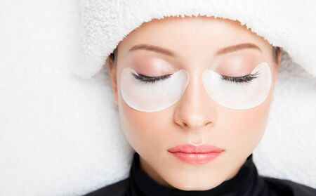 Macro photo woman with long lashes in beauty salon. Concept eyelash extension procedure