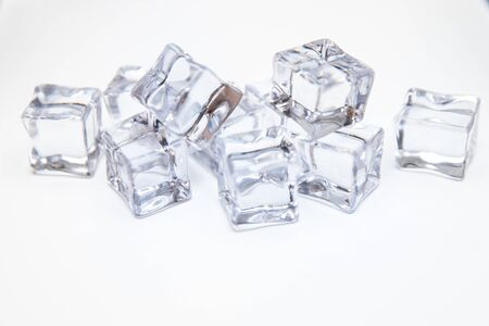 Ice cubes square with drops water clean on white background