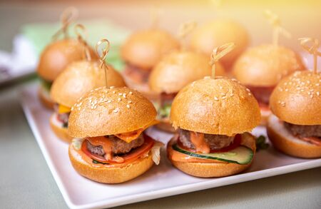 Restaurant food mini burger table with snack delicious dining. Catering service 스톡 콘텐츠