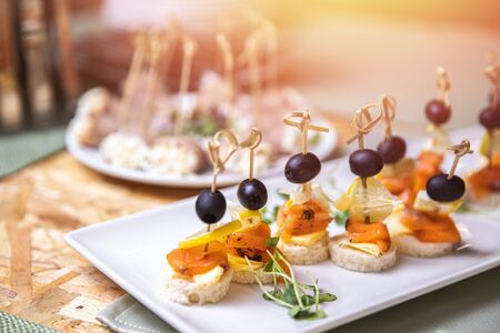 Catering service. Restaurant food canapes table with snack delicious dining
