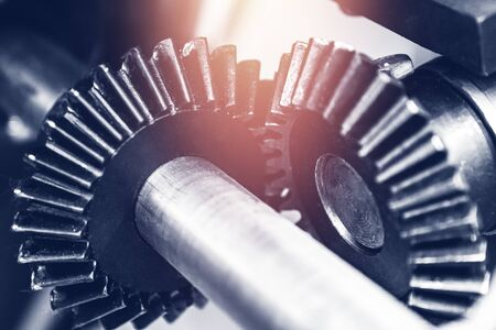 Engine gear wheels with sun light, abstract industrial blue background Stock fotó