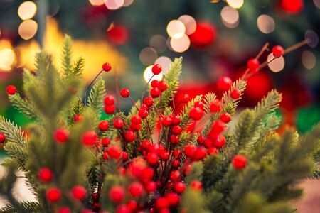 Christmas red pine tree with background bokeh light, New Year sign.