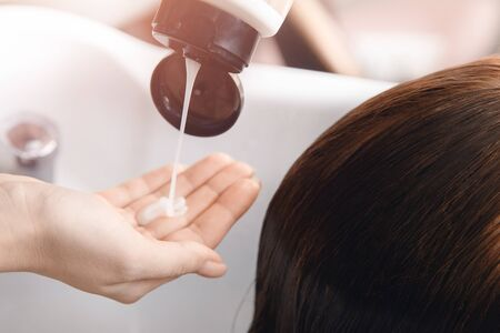 Girl in beauty salon. Wash your hair, care, health. Process of washing head hairdresser