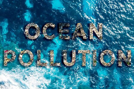 Concept environmental text ocean pollution water with plastic and human waste Stok Fotoğraf