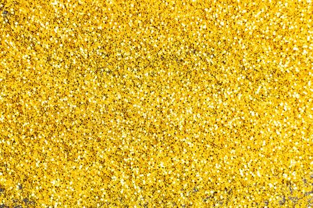 Glitter gold grunge blur abstract background. Lights twinkly dust and christmas texture. Stock Photo
