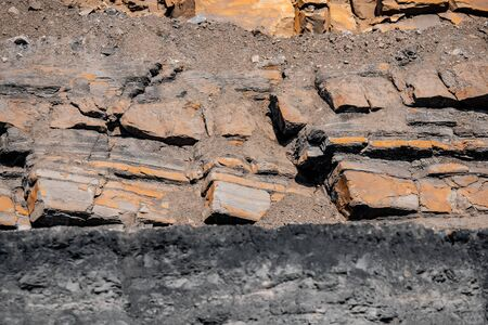 Geological section of soil, layers of coal and rock. Overburden open mine anthracite. Dark texture black color.