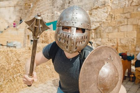 Selfie photo of man wearing knight helmet with armor Viking festival, Malta