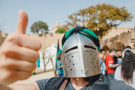 Selfie photo of male Viking cosplay in knights helmet with armor Crusaders festival Stock Photo