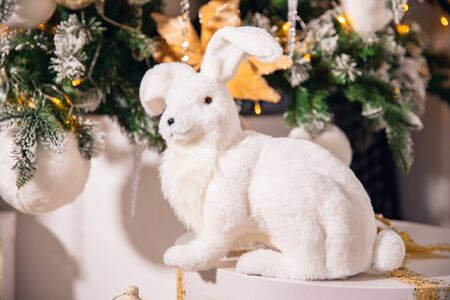 White artificial rabbit hares on background of Christmas tree Zdjęcie Seryjne