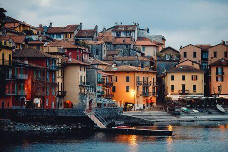 Evening view city Bellagio and Varenna Como water lake Italy blue sky mountain