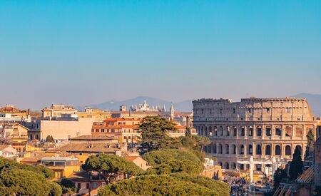 Panorama Rome Italy, sunset city Colosseum ruins Roman Forum from square of Venice