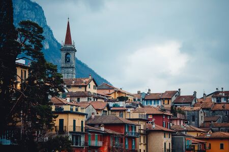 Evening view city Bellagio and Varenna Como water lake Italy blue sky mountain.