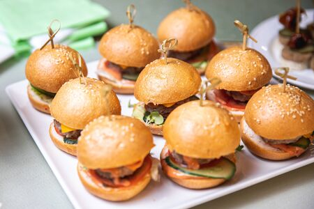Restaurant food mini burger table with snack delicious dining. Catering service Reklamní fotografie