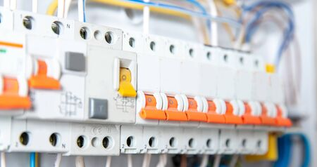 Close up elements of consumer electric control panel switchboard for home enclosure for distribution and power electricity Standard-Bild