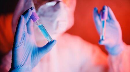 blood test, nurse in white hazmat protective epidemic.