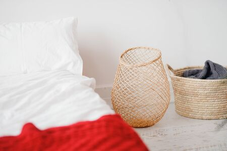 Minimalism Scandinavian style bedroom with white walls laundry basket.