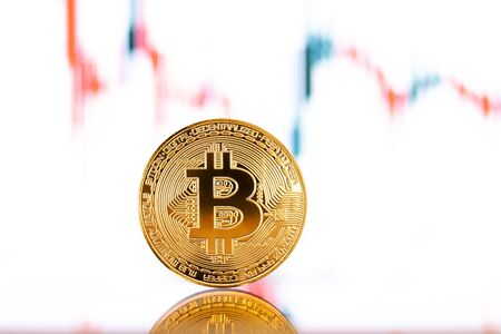 Gold Bitcoin crypto currency on background of chart diagram Stock Photo