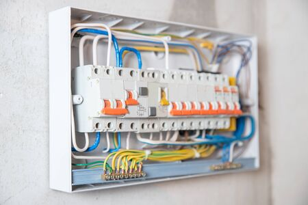 Consumer electric switchboard control panel for home enclosure for distribution and power electricity white background. Uninterrupted voltage Foto de archivo
