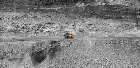 Big yellow mining truck coal transportation. Open pit mine industry.