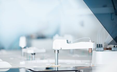 Automatic robot manipulator microbiologist analyzing test tube of blood samples for viruses. Concept vaccine search coronavirus 2019-nCoV