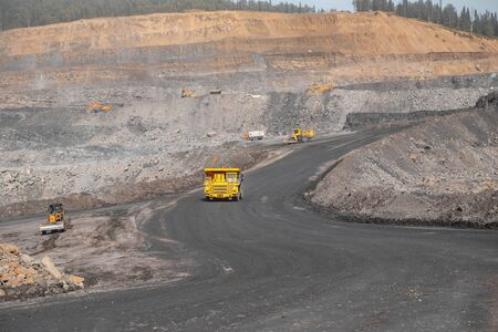 Yellow mining truck move Open pit mine industry.