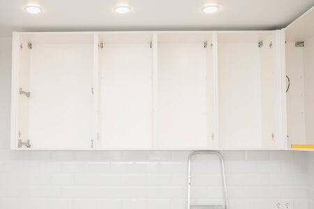 Kitchen installation, door cabinet front assembling furniture white carved.