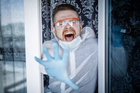 Man of house is quarantined, nervous breakdown after isolation home, tantrum and scream window. Phobia virus concept