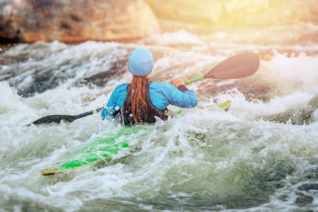 Young woman on kayak with spray paddle. Concept travel summer day