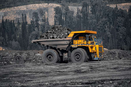 Open pit mine industry, big yellow mining truck for coal anthracite Foto de archivo