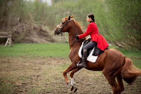Woman jockey performs candle trick on horse racetrack
