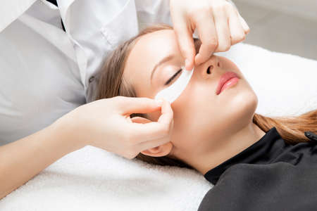 Spa anti-aging treatment, skin care patches in beauty salon Banco de Imagens