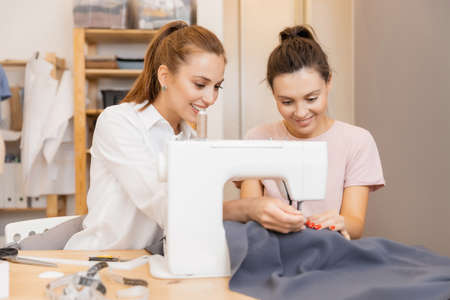 Fashion designers clothes young girls discuss color and shape, dress sewing style