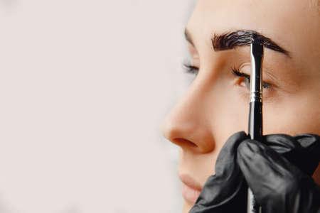 Master tinting of eyebrow hair women, brow correction