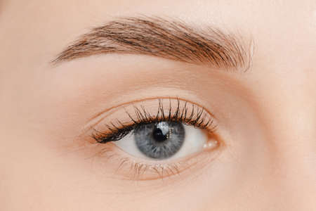 Young woman with beautiful eyebrows. Correction of brow hair