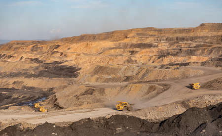 Open pit mine industry, big yellow mining truck for coal move