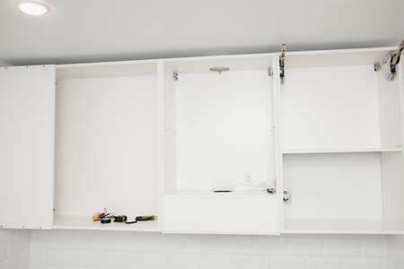 Kitchen installation, door cabinet front assembling furniture white carved
