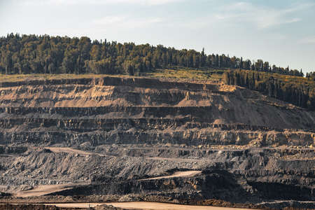Geological section of soil, layers of coal and rock. Overburden open mine anthracite. Dark texture black color