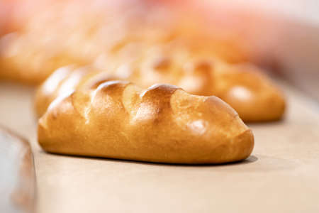 Baked breads on automatic production line bakery from hot oven