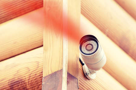Security CCTV camera in private wooden house building, protection and video recording Imagens