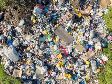 Land pollution with plastic bottles and bags. Open storage of solid waste garbage. Aerial top view