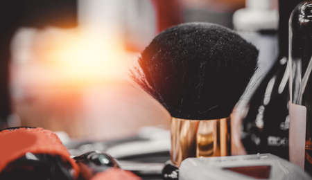 Brush for shaving beard along with bowl, blurred background hair salon for men, barber shop
