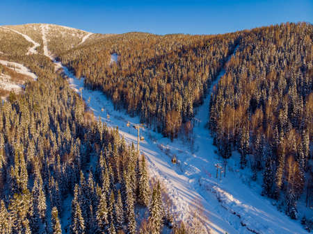 Sheregesh ski lift resort in winter, landscape on mountain and hotels, aerial top view Kemerovo region Russia