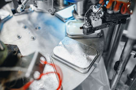 Automatic equipment for packing boxes with foil, dairy products, processed cheese