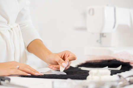 Sewing underwear process. Seamstress tailor in manufacturing fabric