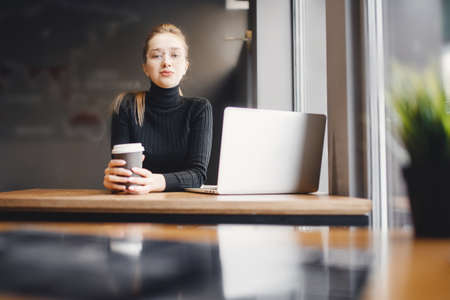 Woman works remotely online from home while quarantine is in effect. Concept of checking mail, blogger