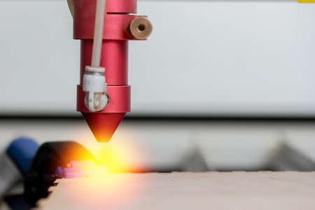 Laser CNC cutting wood. Modern machine industrial technology