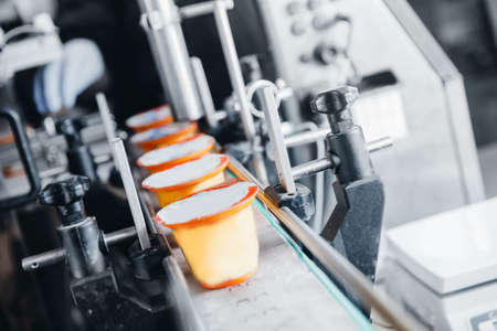 Dairy production, bottle of yoghurt on automated conveyor line, process of milk filling and packaging 写真素材